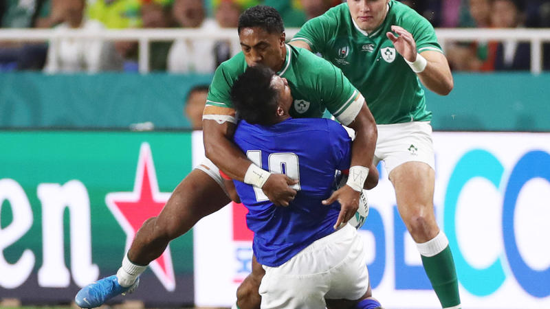 Bundee Aki of Ireland tackles Ulupano Seuteni of Samoa too high which later leads to a red card. (Photo by David Ramos - World Rugby/World Rugby via Getty Images)