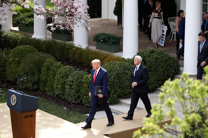 President Donald Trump arrives with Vice President Mike Pence for a news conference about the coronavirus in the Rose Garden at the White House, Friday, March 13, 2020, in Washington. (AP Photo/Alex Brandon) ORG XMIT: DCAB311