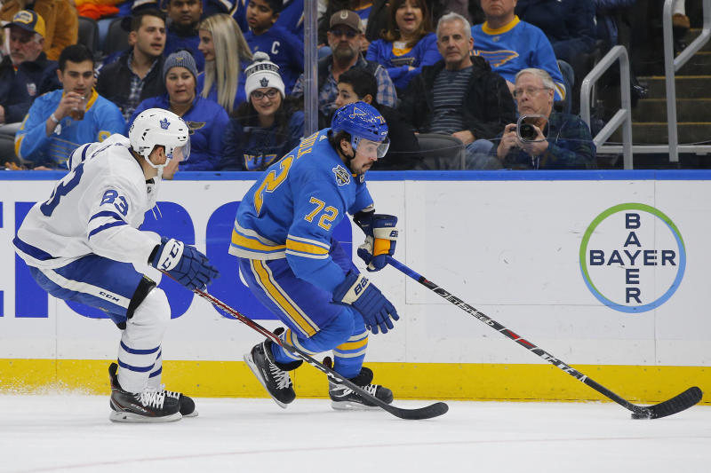 St. Louis Blues' Justin Faulk, right, skates with the puck as he is trailed by Toronto Maple Leafs' Cody Ceci during the second period of an NHL hockey game Saturday, Dec. 7, 2019, in St. Louis. (AP Photo/Billy Hurst)
