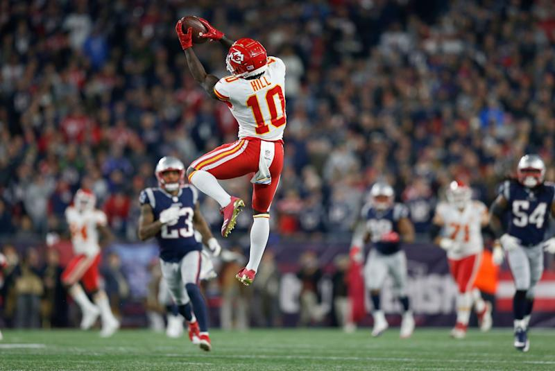 Kansas City Chiefs wide receiver Tyreek Hill (10) catches a pass that he ran in for a touchdown during the second half of an NFL football game against the New England Patriots, Sunday, Oct. 14, 2018, in Foxborough, Mass. (AP Photo/Michael Dwyer)