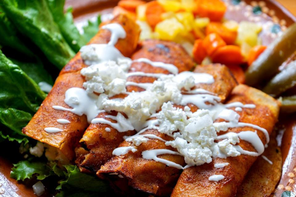 """<p>The best part of any Mexican dish is all that cheese. These easy queso fresco enchiladas are loaded with the good stuff and pair wonderfully with more of <a href=""""https://www.thedailymeal.com/cook/best-mexican-recipes?referrer=yahoo&category=beauty_food&include_utm=1&utm_medium=referral&utm_source=yahoo&utm_campaign=feed"""" rel=""""nofollow noopener"""" target=""""_blank"""" data-ylk=""""slk:our best Mexican recipes"""" class=""""link rapid-noclick-resp"""">our best Mexican recipes</a>.</p> <p><a href=""""https://www.thedailymeal.com/best-recipes/queso-fresco-enchiladas?referrer=yahoo&category=beauty_food&include_utm=1&utm_medium=referral&utm_source=yahoo&utm_campaign=feed"""" rel=""""nofollow noopener"""" target=""""_blank"""" data-ylk=""""slk:For the Queso Fresco Enchiladas recipe, click here."""" class=""""link rapid-noclick-resp"""">For the Queso Fresco Enchiladas recipe, click here.</a></p>"""