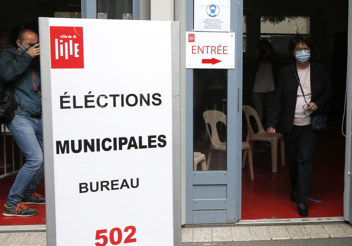 Current socialist Lille mayor and candidate in the second round of the municipal elections, Martine Aubry exits a polling booth before casting her vote, Sunday, June 28, 2020 in Lille, northern France. France is holding the second round of municipal elections in 5,000 towns and cities Sunday that were postponed due to the country's coronavirus outbreak.(AP Photo/Michel Spingler)
