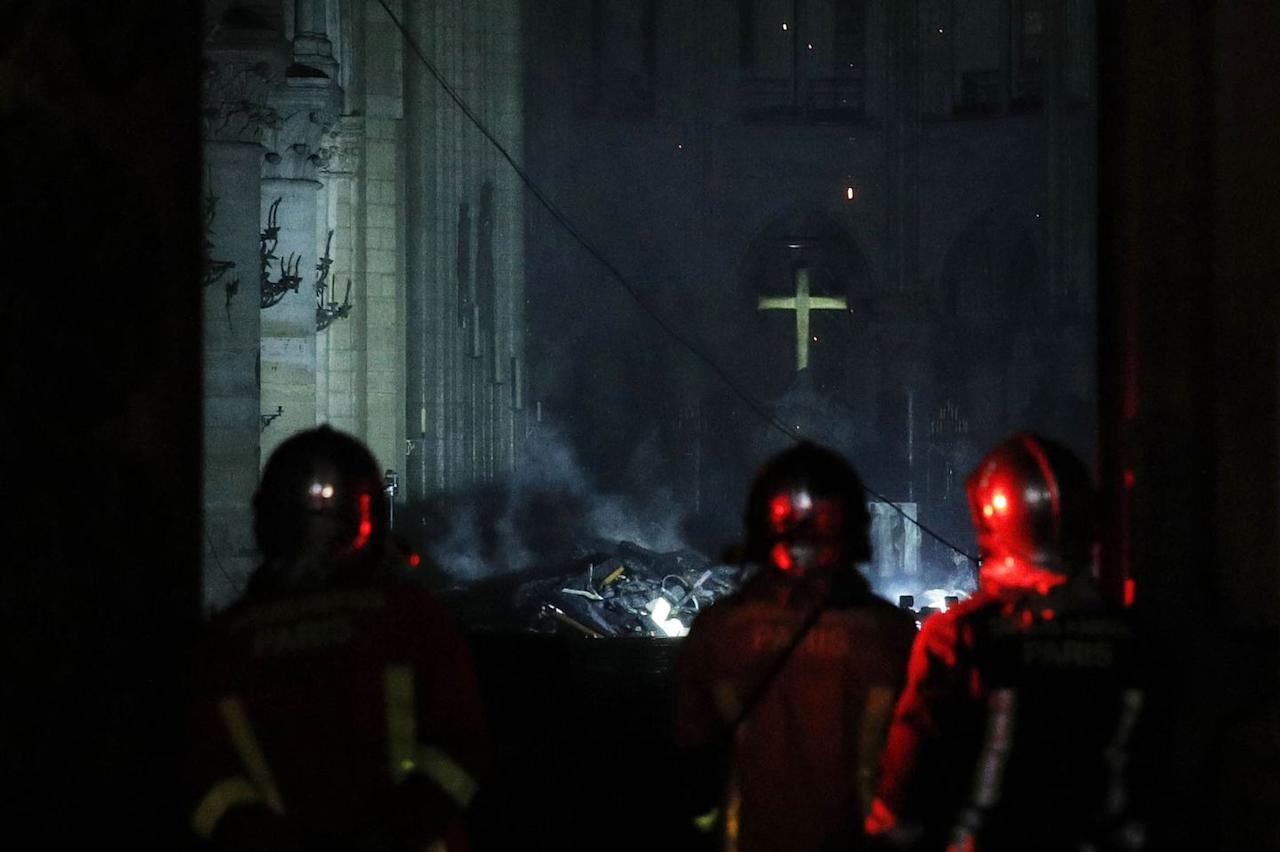 <p>French firemen enter the Notre-Dame Cathedral as flames on April 16, 2019.</p>