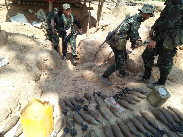 In this photo provided by Karen National Liberation Army, a Karen National Liberation Army soldier holds a mortar shell found at a Myanmar military outpost Friday, May 7, 2021, in Mutraw district, Karen State, Myanmar. Ethnic Karen guerrillas burned down a Myanmar military outpost Friday morning, capturing it without a fight after its garrison fled at their approach, a senior Karen officer said on Friday (Karen National Liberation Army via AP)