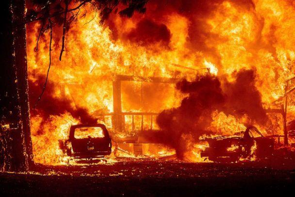 PHOTO: Flames consume a home on Highway 89 as the Dixie Fire tears through the Greenville community of Plumas County, Calif., Aug. 4, 2021.  (Noah Berger/AP)