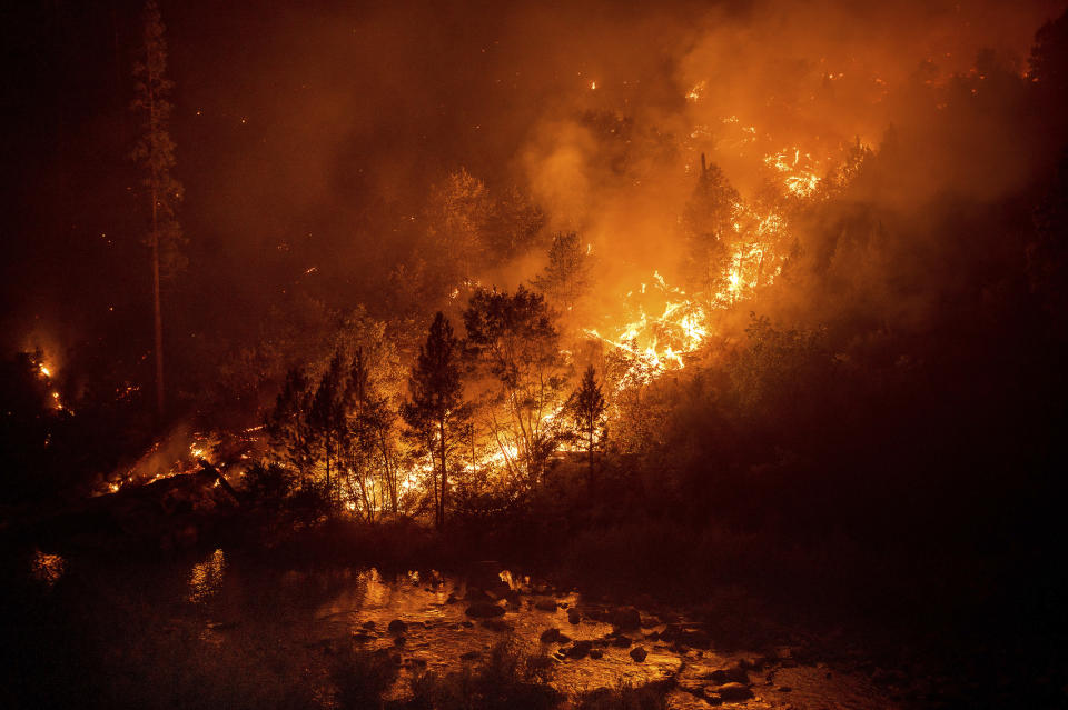 The Caldor Fire burns above the South Fork of the American River in the White Hall community of El Dorado County, Calif., on Friday, Aug. 27, 2021. (AP Photo/Noah Berger)
