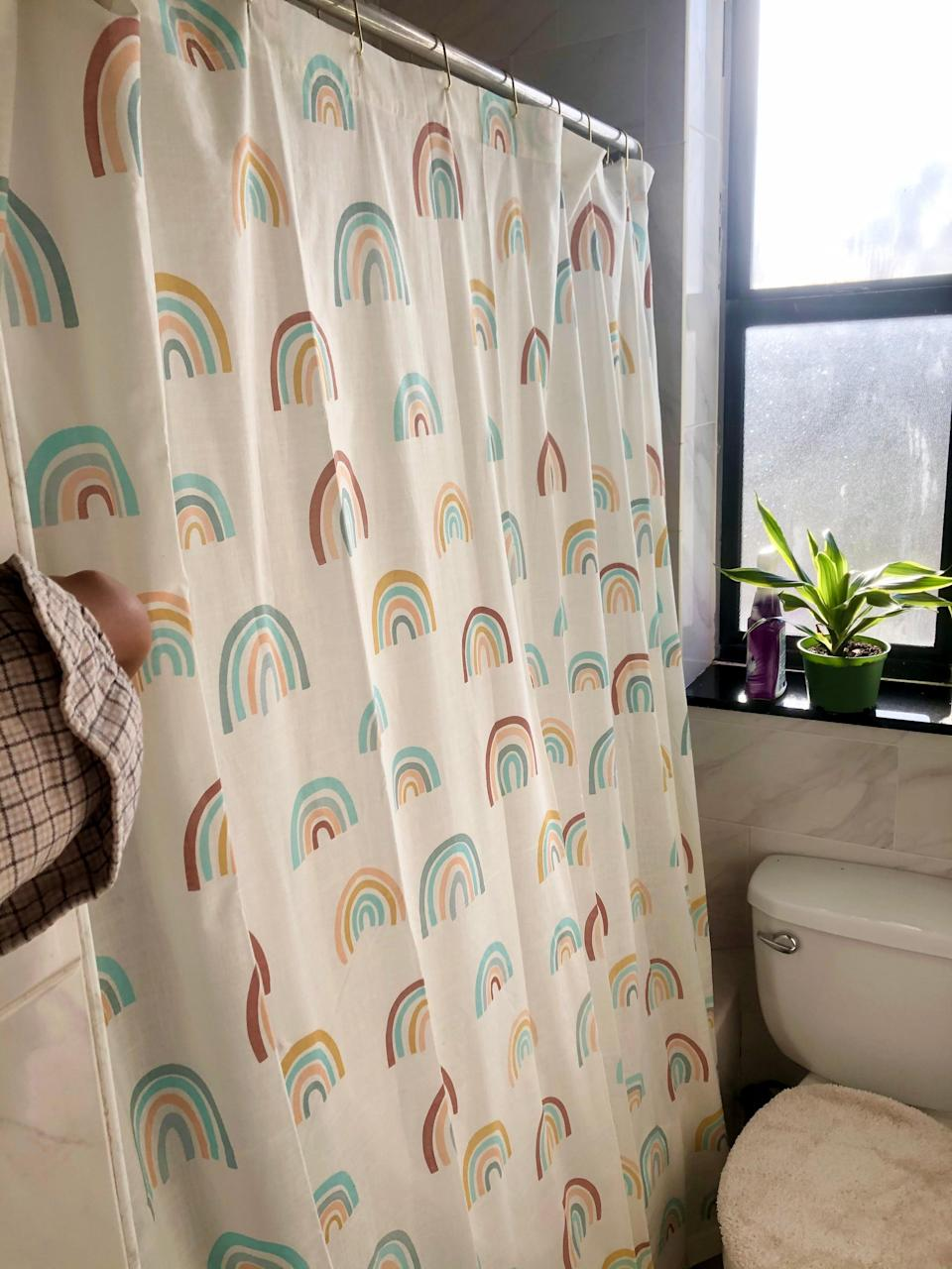"<h2>World Market Muted Shower Curtain</h2><br>""Finding an aesthetically pleasing shower curtain that doesn't cost an exorbitant amount or feel like a piece of printer paper is oddly cumbersome. I snagged this one from World Market (for under $30!) and I'm obsessed with how it's covered in rainbows but has muted hues so it doesn't overwhelm my itty bitty bathroom. It has a cloth-like texture and is 100% cotton which makes it flow nicely over the tub. I definitely recommend getting a liner as well for the ultimate cute shower experience."" <em>– Alexandra Polk, Lifestyle Writer</em><br><br><em>Shop <strong><a href=""https://www.worldmarket.com/product/muted+rainbow+shower+curtain.do"" rel=""nofollow noopener"" target=""_blank"" data-ylk=""slk:World Market"" class=""link rapid-noclick-resp"">World Market</a></strong></em><br><br><strong>Cost Plus World Market</strong> Muted Rainbow Shower Curtain, $, available at <a href=""https://go.skimresources.com/?id=30283X879131&url=https%3A%2F%2Ffave.co%2F3umJe0E"" rel=""nofollow noopener"" target=""_blank"" data-ylk=""slk:Cost Plus World Market"" class=""link rapid-noclick-resp"">Cost Plus World Market</a>"