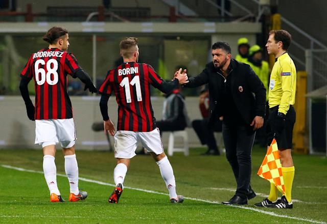 Soccer Football - Europa League Round of 32 Second Leg - AC Milan vs PFC Ludogorets Razgrad - San Siro, Milan, Italy - February 22, 2018 AC Milan's Fabio Borini celebrates scoring their first goal with coach Gennaro Gattuso REUTERS/Tony Gentile