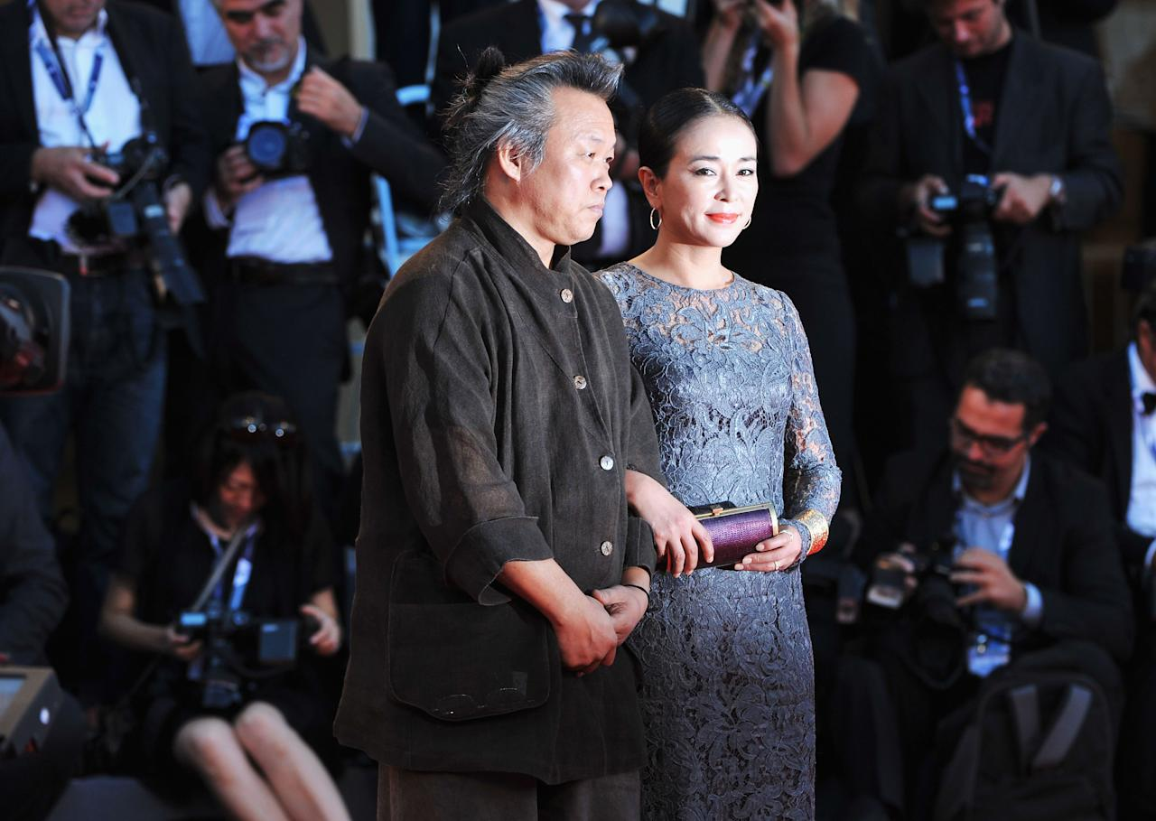 "VENICE, ITALY - SEPTEMBER 08:  Actress Cho Min-soo and director Kim Ki-duk attend the Award Ceremony And ""L'Homme Qui Rit"" Premiere during The 69th Venice Film Festival at the Palazzo del Cinema on September 8, 2012 in Venice, Italy.  (Photo by Christine Pettinger/Getty Images)"