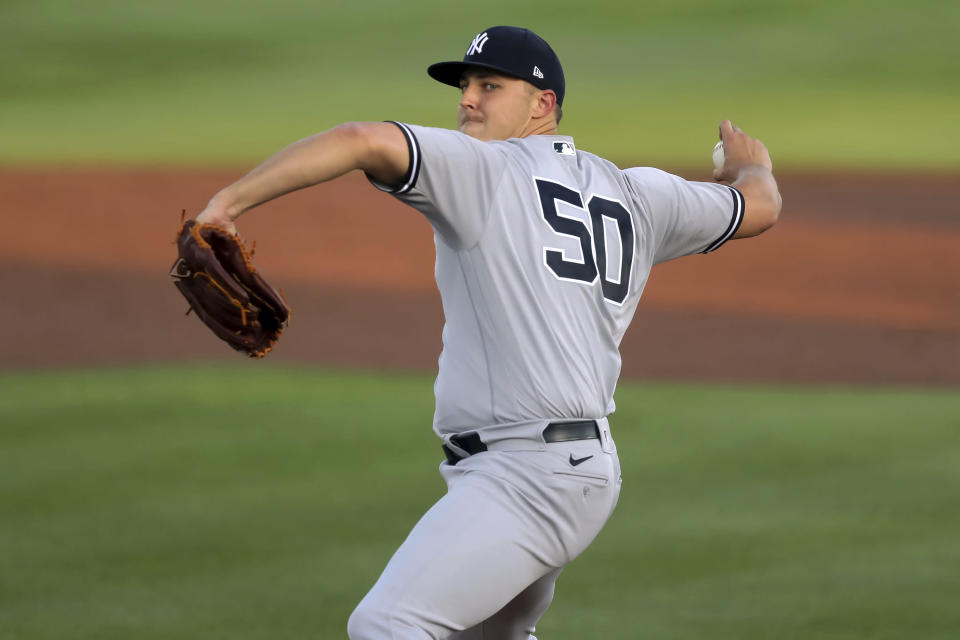 New York Yankees starting pitcher Jameson Taillon throws to a Toronto Blue Jays batter during the first inning of a baseball game Tuesday, April 13, 2021, in Dunedin, Fla. (AP Photo/Mike Carlson)