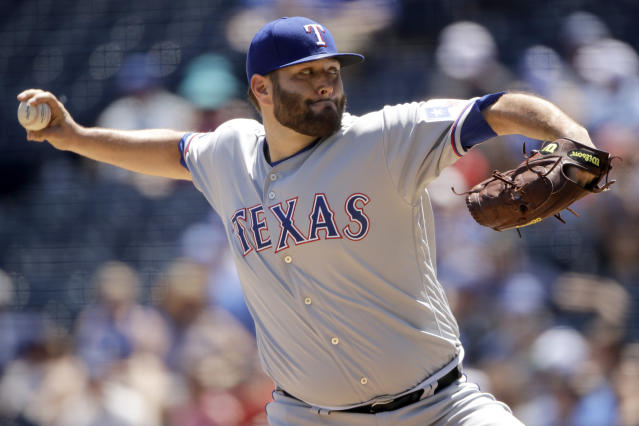Texas Rangers starting pitcher Lance Lynn throws during the first inning of a baseball game against the Kansas City Royals, Thursday, May 16, 2019, in Kansas City, Mo. (AP Photo/Charlie Riedel)