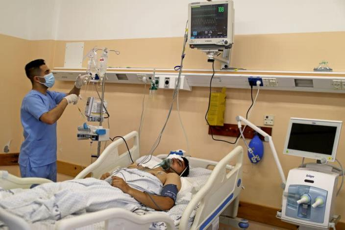 Gaza health system fight on two fronts, Covid-19 and war with Israel