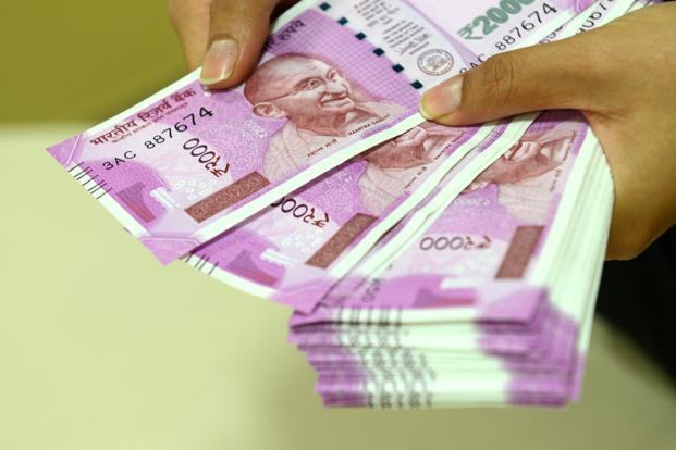 Rupee hits 5-month high vs US dollar, then erases gains