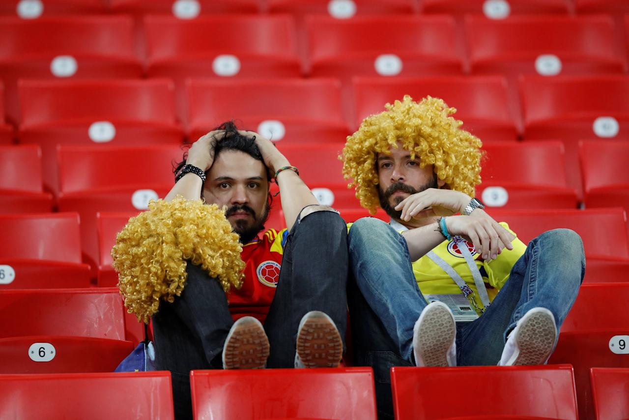 <p>Colombia fans look dejected after losing the penalty shootout. REUTERS/Carl Recine </p>