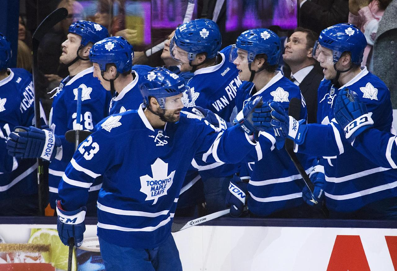 Toronto Maple Leafs' Trevor Smith celebrates his goal against the New York Islanders during the first period of an NHL hockey game, Tuesday, Nov. 19, 2013 in Toronto. (AP Photo/The Canadian Press, Mark Blinch)
