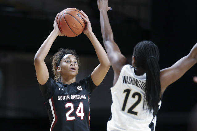 South Carolina guard LeLe Grissett (24) looks for help as she is defended by Vanderbilt's Demi Washington (12) in the first half of an NCAA college basketball game Sunday, Jan. 12, 2020, in Nashville, Tenn. (AP Photo/Mark Humphrey)