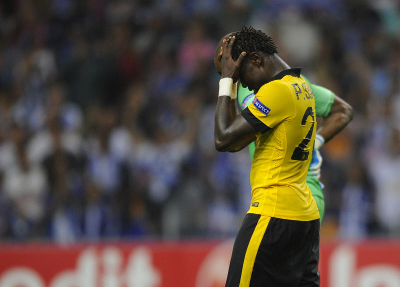 Lille's Senegalese defender Pape Souare holds his head during the UEFA Champions League play-off second leg football match FC Porto vs Lille at the Dragao Stadium in Porto, on August 26, 2014. Porto won the match 2-0