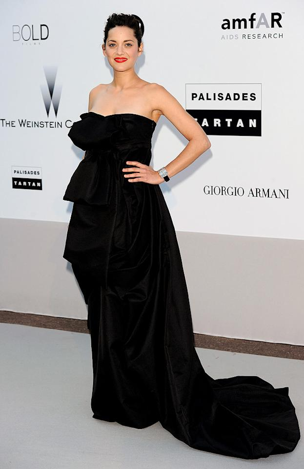 "Overwhelmed by the voluminous design of her black gown, Marion Cotillard suffered a rare fashion misstep on the Cannes red carpet. Venturelli/<a href=""http://www.wireimage.com"" target=""new"">WireImage.com</a> - May 20, 2010"
