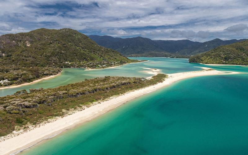 This undated handout file photo shows Awaroa beach at Awaroa inlet, an 800-metre (2,600-foot) stretch of golden sand adjoining the Abel Tasman National Park at the top of New Zealand's South Island. - STR/AFP PHOTO / BAYLEYS REAL ESTATE / STR