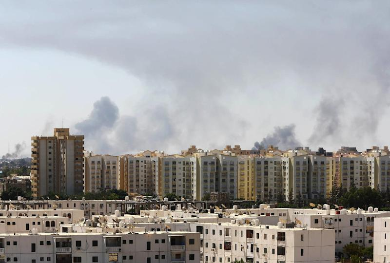 Smoke billows from a road leading to Tripoli's international airport amid fighting between rival factions on July 23, 2014