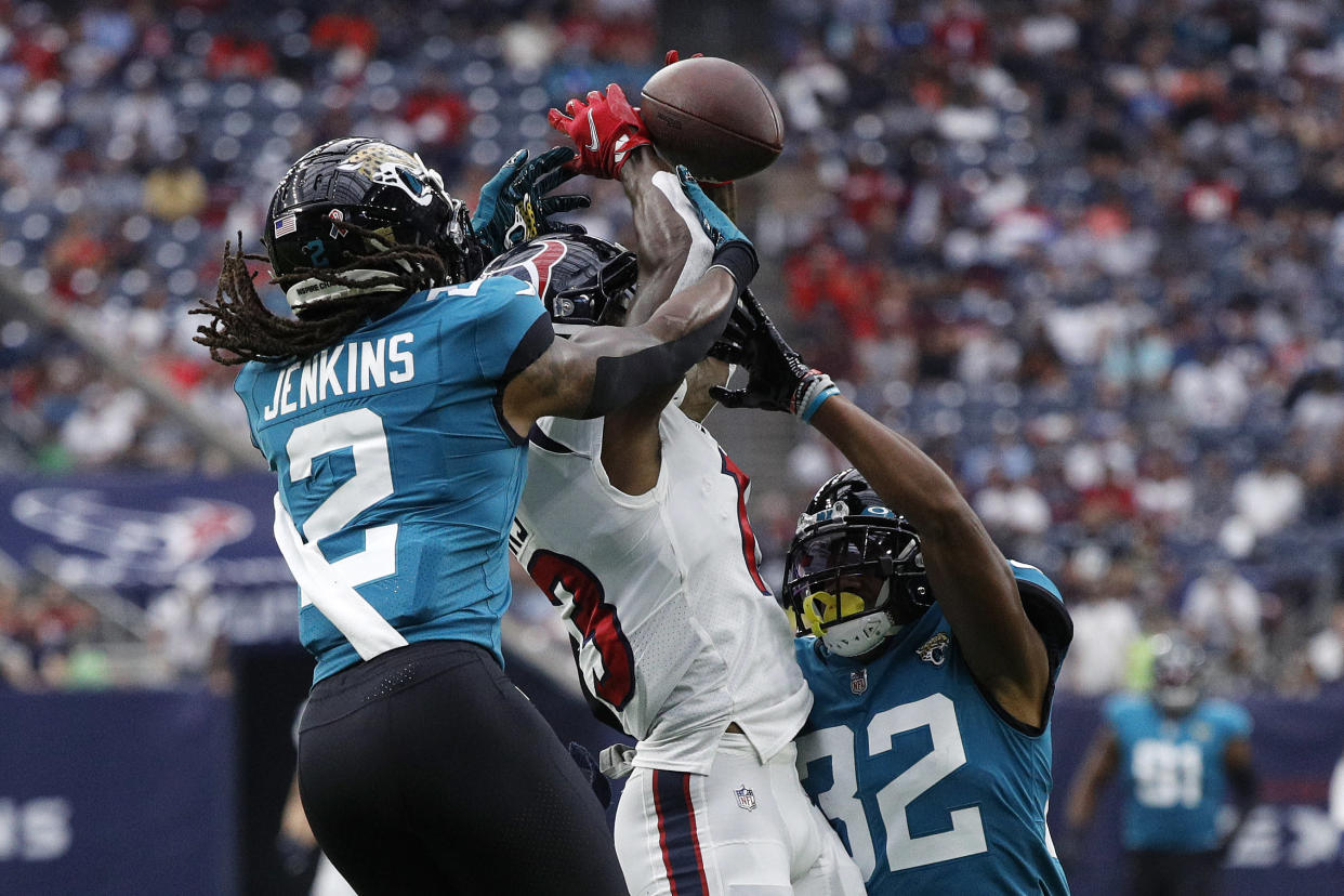 HOUSTON, TEXAS - SEPTEMBER 12: Brandin Cooks #13 of the Houston Texans attempts to make a catch against Rayshawn Jenkins #2 of the Jacksonville Jaguars during the first quarter at NRG Stadium on September 12, 2021 in Houston, Texas. (Photo by Bob Levey/Getty Images)