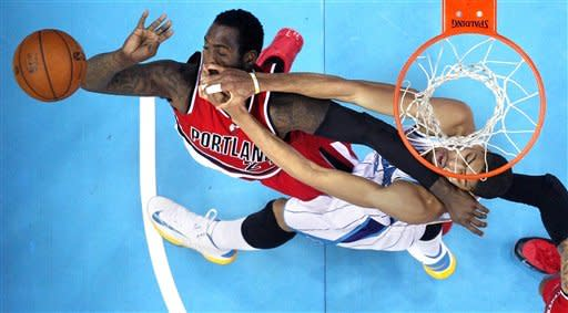 Portland Trail Blazers center J.J. Hickson, left, and New Orleans Hornets forward Anthony Davis (23) battle for a loose ball in the first half of an NBA basketball game in New Orleans, Sunday, March 10, 2013. (AP Photo/Gerald Herbert)