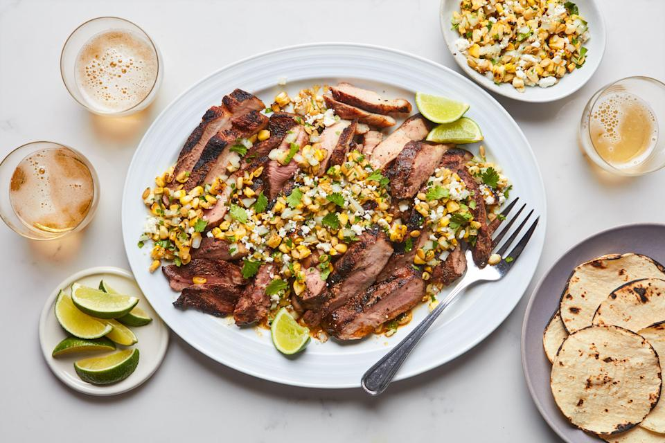 """Cut into steaks, pork shoulder is a well-marbled, quick-cooking cut that's terrific for grilling—especially when seasoned with a Mexican-inspired rub. <a href=""""https://www.epicurious.com/recipes/food/views/chipotle-grilled-pork-shoulder-steaks-with-corn-salsa?mbid=synd_yahoo_rss"""" rel=""""nofollow noopener"""" target=""""_blank"""" data-ylk=""""slk:See recipe."""" class=""""link rapid-noclick-resp"""">See recipe.</a>"""