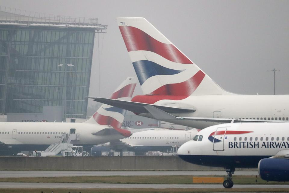 LONDON, ENGLAND - OCTOBER 25: British Airways planes taxi near Heathrow's Terminal 5 on October 25, 2016 in London, England. At a cabinet committee meeting today the government approved a third runway at Heathrow airport. Many people in the nearby village of Harmondsworth are strongly opposed to the third Heathrow runway as it would likely mean the demolition of the village. (Photo by Dan Kitwood/Getty Images)
