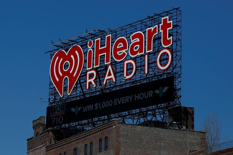 The iHeartMedia billboard is seen atop a building in the Bronx in New York