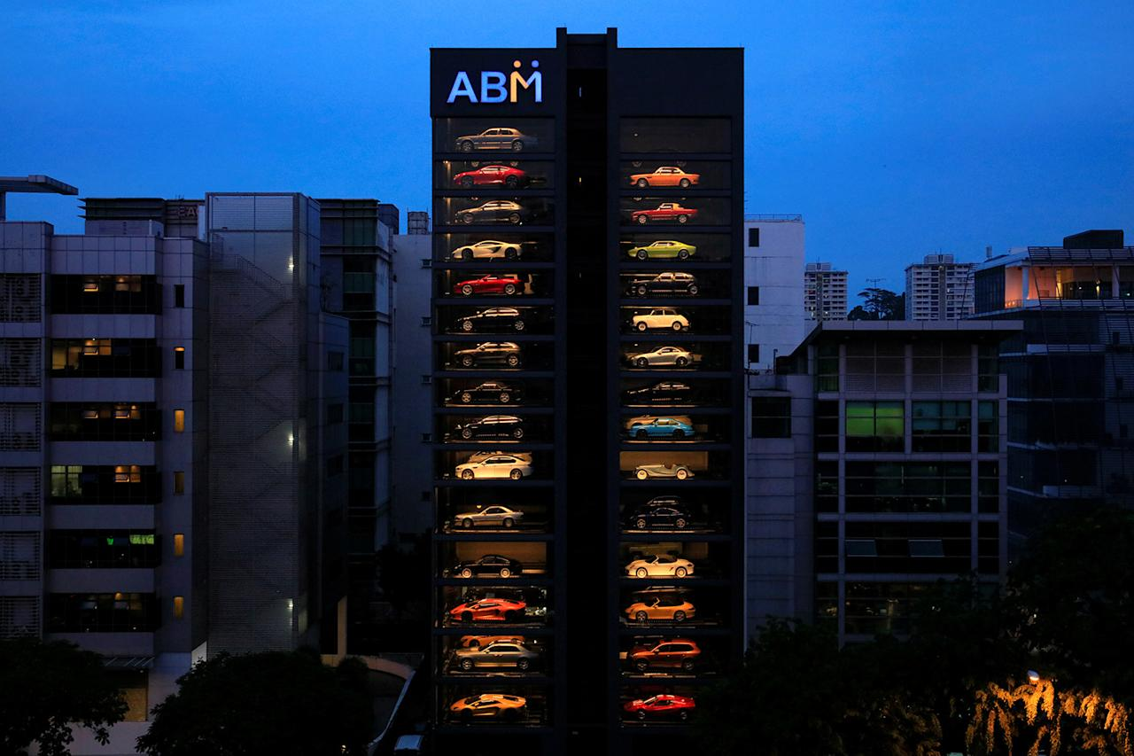 <p>An exotic used car dealership designed to resemble a vending machine in Singapore May 15, 2017. The dealership houses up to 60 exotic cars in a 15 storey building which uses a fish-bone type lift system to deliver cars to clients within minutes. (Photo: Thomas White/Reuters) </p>