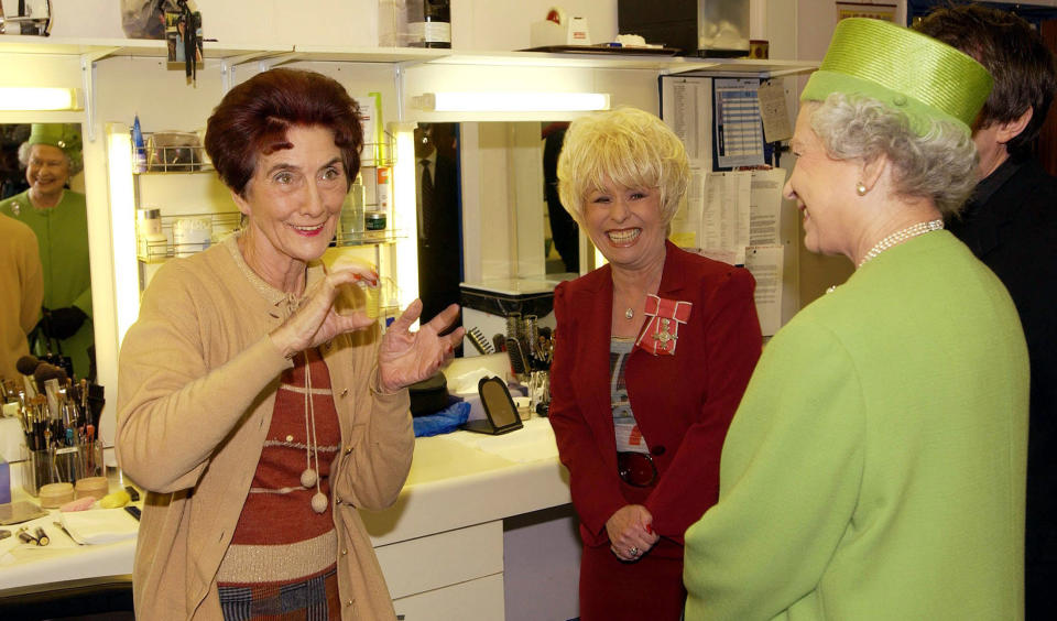 Queen Elizabeth ll is shown around by Barbara Windsor and meets June Brown who plays Dot Cotton in the make-up room during a visit to the set of the soap 'Eastenders' on November 28, 2001 in London, England. (Photo by Anwar Hussein/Getty Images)