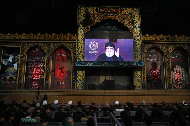 """Hezbollah leader Sayyed Hassan Nasrallah, speaks via a video link, during the first day of Ashoura, in the southern suburb of Beirut, Lebanon, Saturday, Aug. 31, 2019. TThe leader of Lebanon's Hezbollah categorically denied Israeli claims about his group having factories to produce precision-guided missiles in Lebanon, saying such """"likes"""" were an attempt to justify Israeli attacks against the country. (AP Photo/Hussein Malla)"""