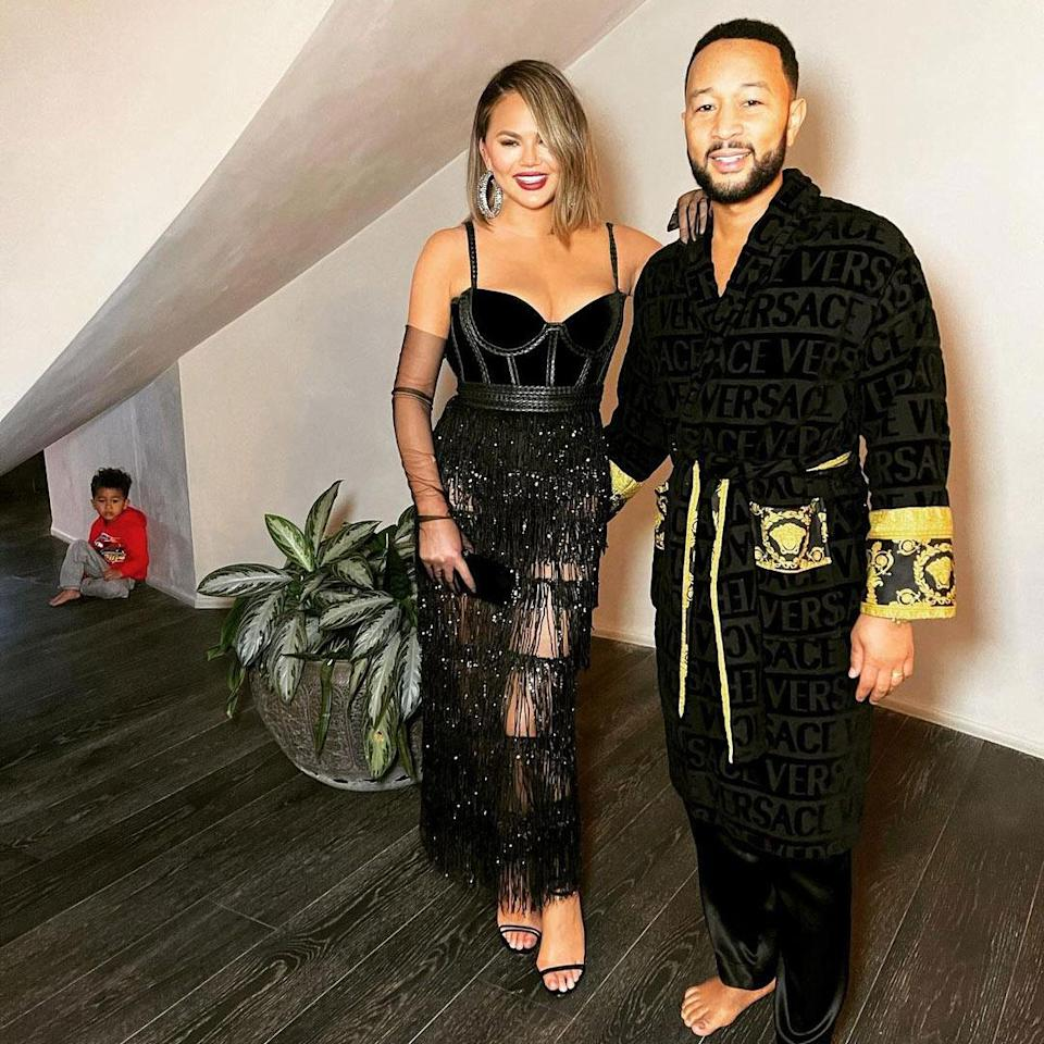 """<p>""""House Grammys 2021!!!"""" the mom of two captioned <a href=""""https://www.instagram.com/p/CMbEYJ9hDEg/"""" rel=""""nofollow noopener"""" target=""""_blank"""" data-ylk=""""slk:this sweet photo"""" class=""""link rapid-noclick-resp"""">this sweet photo</a> with her musical husband, who won the R&B Album Grammy for <em>Bigger Love</em>. Their son Miles, 2, even snuck in the background of the picture! </p>"""
