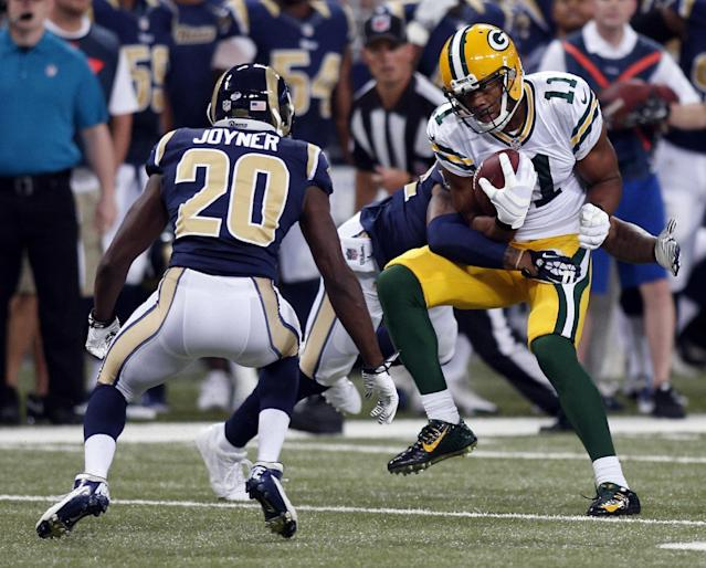 Green Bay Packers wide receiver Jarrett Boykin, right, catches a pass for a 7-yard gain as St. Louis Rams cornerback Lamarcus Joyner (20) defends during the first quarter of an NFL preseason football game Saturday, Aug. 16, 2014, in St. Louis. (AP Photo/Scott Kane)