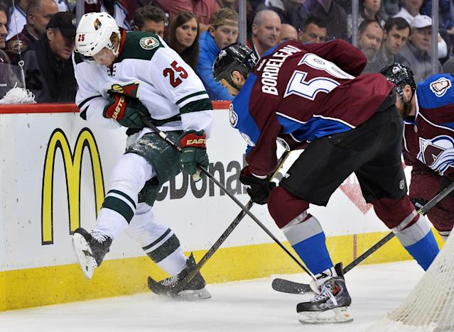 Minnesota Wild defenseman Jonas Brodin (25) of Sweden and left wing Patrick Bordeleau (58) go after the puck in the first period during Game 7 of an NHL hockey first-round playoff series on Wednesday, April 30, 2014, in Denver. (AP Photo/Jack Dempsey)