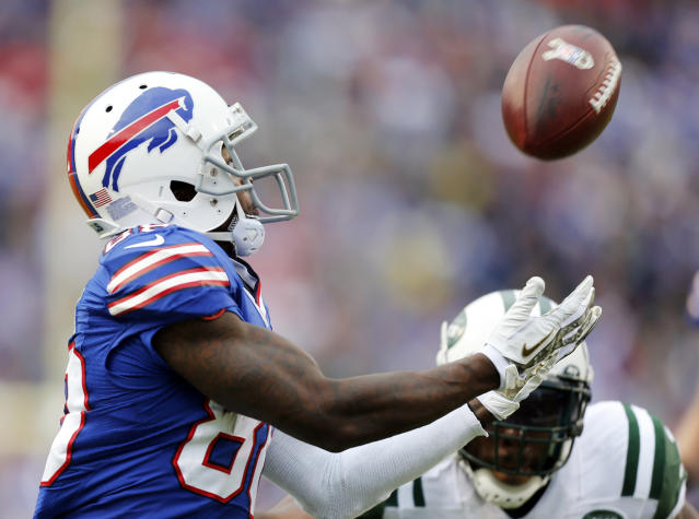 Buffalo Bills wide receiver Marquise Goodwin (88) makes a touchdown catch in front of New York Jets cornerback Antonio Cromartie during the second half of an NFL football game on Sunday, Nov. 17, 2013, in Orchard Park, N.Y. (AP Photo/Gary Wiepert)