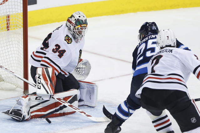 Chicago Blackhawks goaltender J-F Berube stops a shot by Winnipeg Jets center Paul Stastny (25) during the third period of an NHL hockey game Thursday, March 15, 2018, in Winnipeg, Manitoba. (John Woods/The Canadian Press via AP)