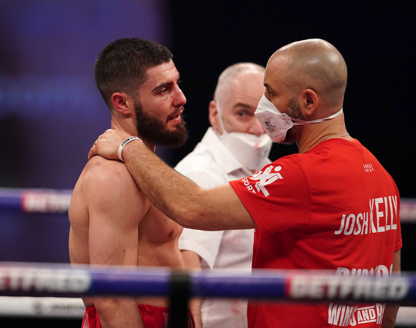 Josh Kelly is comforted by trainer Adam BoothDave Thompson