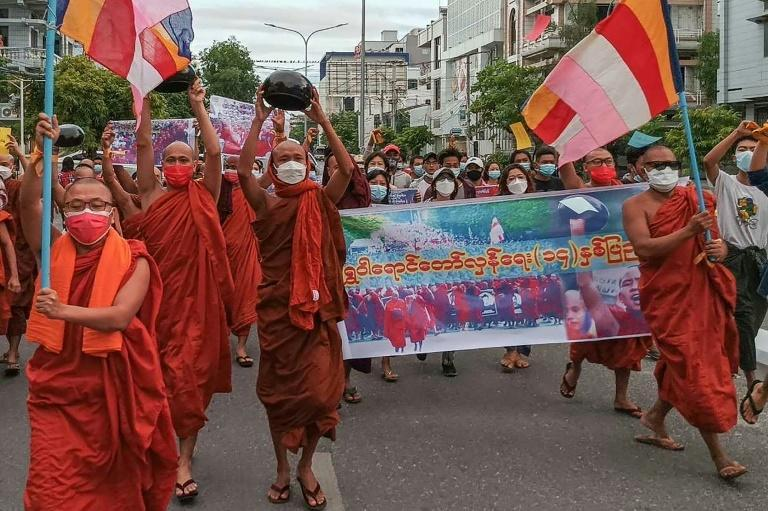 Myanmar's coup has exposed a schism in the monkhood, with some prominent clerics even giving the generals their blessing and others supporting the protesters (AFP/STR)