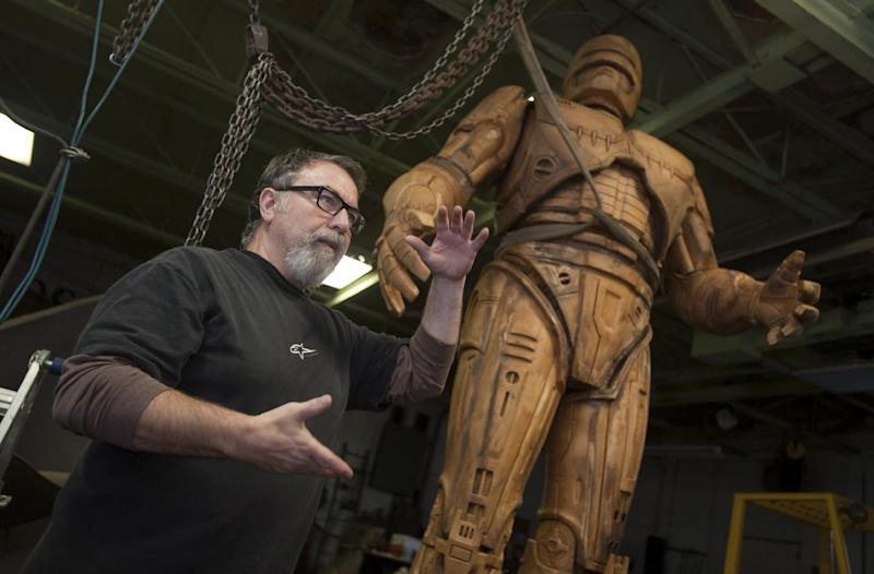 Giorgio Gikas, president of Venus Bronze Works, talks about a foam model of the the fictional crime-fighting cyborg RoboCop statue inside Venus Bronze Works in Detroit , Michigan on Tuesdat, Sept. 24, 2013. Venus Bronze Works in Detroit is getting ready to cast pieces of the statue. After this model is turned into a mold, the finished statue is set to be unveiled in summer of 2014. The 1980s science fiction movie was set in a futuristic and crime-ridden Detroit. (AP Photo/The Detroit News, David Guralnick )