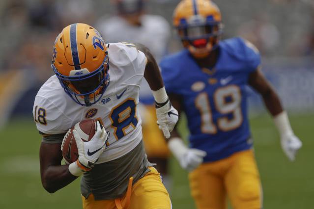 Pittsburgh wide receiver Shocky Jacques-Louis (18), left, runs away from defensive back V'Lique Carter (19)after aiming a catch during their annual intrasquad Blue-Gold spring NCAA college football game, Saturday, April 13, 2019, in Pittsburgh. The Blue team won 14-7. (AP Photo/Keith Srakocic)