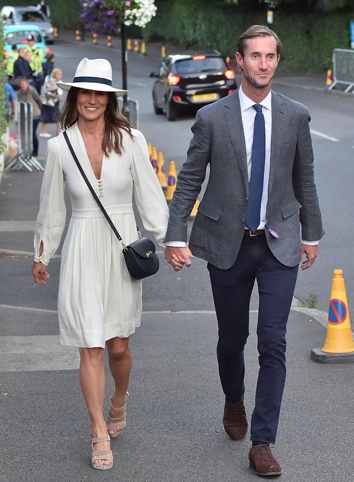 <p>After turning heads in a mint-green number days earlier, Pippa Middleton makes another style statement as she attends Wimbledon on July 14 in an Etoile Isabel Marant Neil ivory crepe dress accessorized with a fedora and tan wedges.  Get the Look: Majorelle Garnet Dress, $198; revolve.com Bebe Flare Cuff Button Dress, $115.99; bebe.com H&M Lace-Trimmed Dress, $49.99; hm.com Sunday Afternoons Havana Hat, $32; llbean.com BP Sky Wedge Sandal, $49.95; nordstrom.com</p>