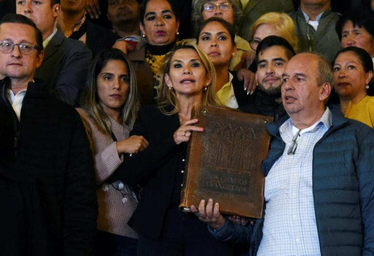 Anez brandished a copy of the Gospels as she arrived at the presidential palace