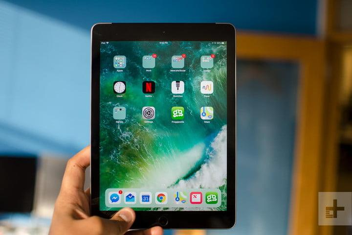 apple ipad 9 7 inch 2018 front in hand