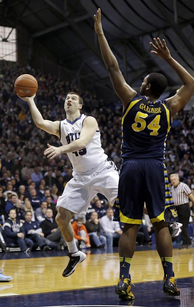 Butler forward Andrew Chrabascz, left, shoots under Davante Gardner in the first half of an NCAA college basketball game in Indianapolis, Saturday, Jan. 18, 2014. (AP Photo/Michael Conroy)