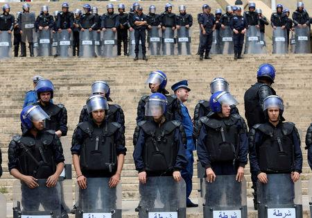 FILE PHOTO: Police stand guard during an anti-government protest in Algiers, Algeria, May 21, 2019.  REUTERS/Ramzi Boudina/File Photo