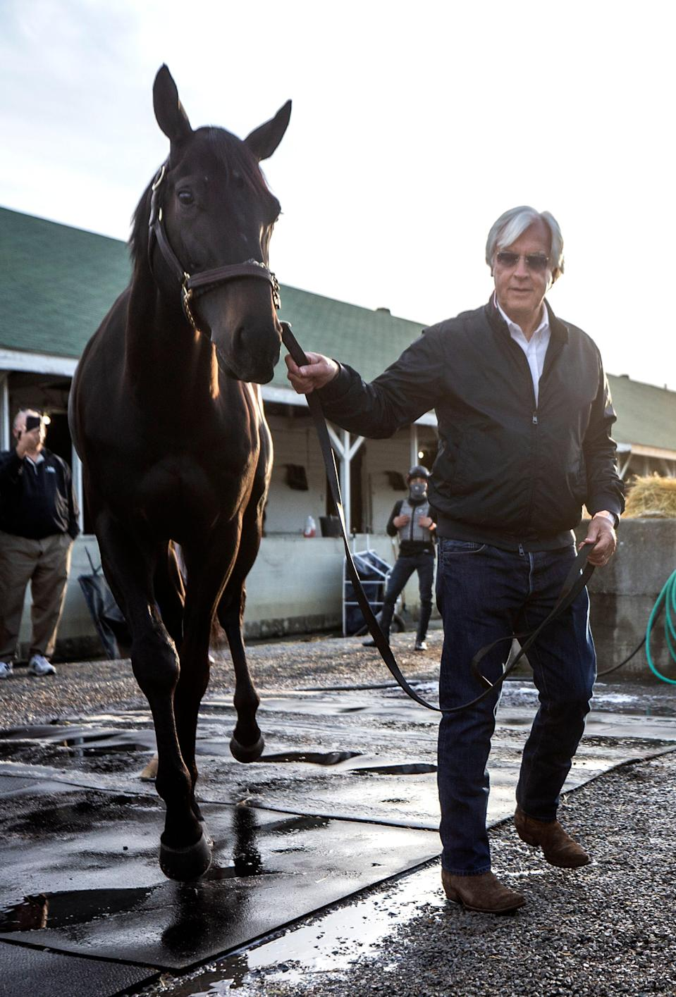 Trainer Bob Baffert leads Medina Spirit back to his stall on the morning after winning his seventh Kentucky Derby with the horse. One week later it was announced that Medina Spirit tested positive for an abundance of an anti-inflammatory drug following the race.