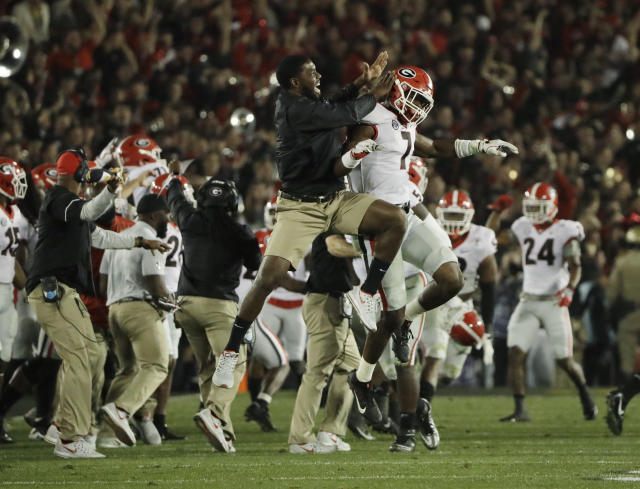 Georgia linebacker Lorenzo Carter (7) celebrates after blocking a field goal against Oklahoma during the second overtime of the Rose Bowl. (AP)