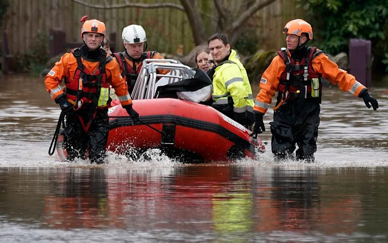 irefighters rescue staff and residents from a care home in the village of Whitchurch on the banks of the River Wye - getty