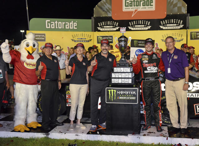 Erik Jones poses for a photo with his trophy after winning a NASCAR Cup Series auto race on Sunday, Sept. 1, 2019, at Darlington Raceway in Darlington, S.C. Jones held off Joe Gibbs Racing teammate Kyle Busch to win the rain-delayed Southern 500 that ended early Monday morning. (AP Photo/Richard Shiro)